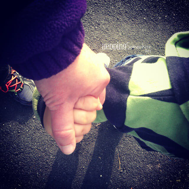 gaining perspective - Asher & Mum hold hands